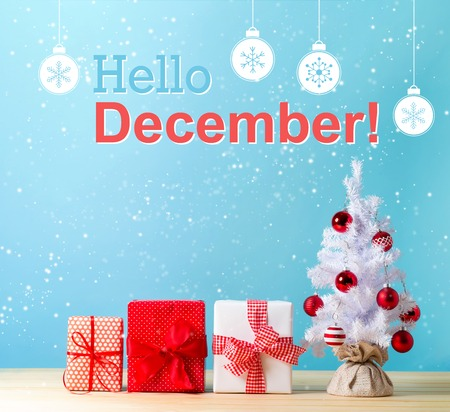 A White Christmas.Hello December Message With A White Christmas Tree And Gift Boxes