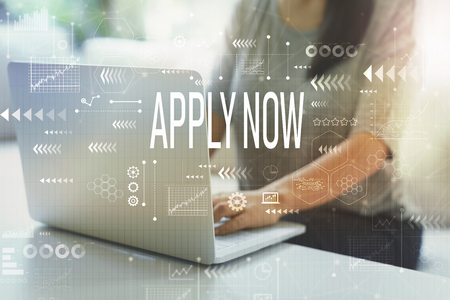 Apply now with woman using her laptop in her home office