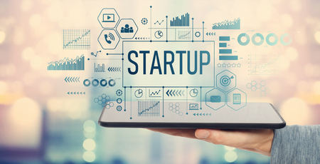 Startup with man holding a tablet computer Stock Photo