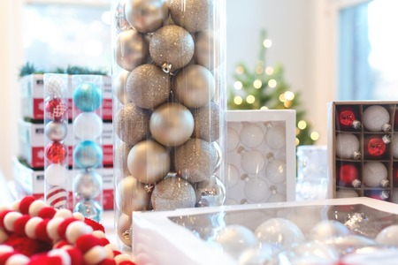 Christmas babule and ornaments in boxes on a table in a room Stock Photo