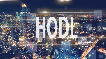 HODL with the New York City skyline at night