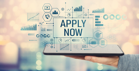 Apply now with man holding a tablet computer