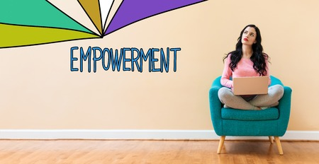 Empowerment with young woman using a laptop computer Stock Photo