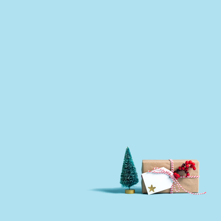 Christmas gift box on a blue background Stock Photo