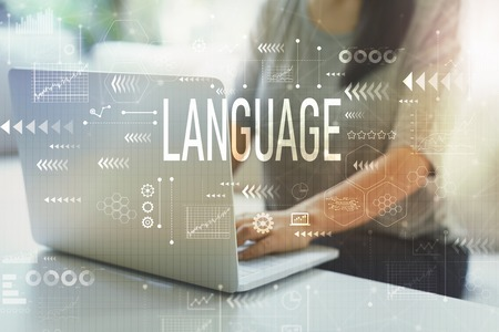 Language with woman using her laptop in her home office