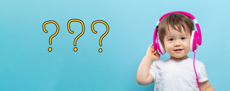 Question marks with toddler boy with headphones on a blue background