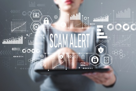 Scam alert with business woman using a tablet computer Фото со стока
