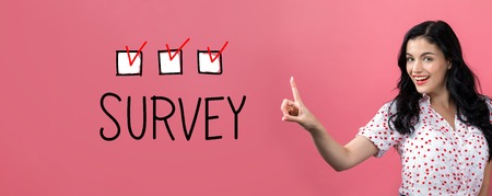 Survey with young woman on a pink background