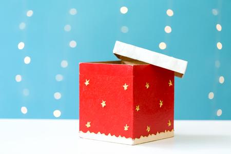 Christmas gift box on a shiny light blue background