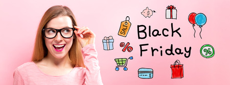 Black Friday with happy young woman holding her glasses Фото со стока