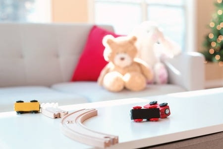 Toy trains on a table in a living room