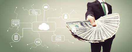 Cloud Computing with business man displaying a spread of cash