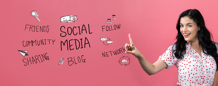 Social media theme with young woman on a pink background Stock Photo