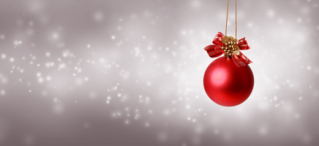 Christmas bauble on a shiny light background