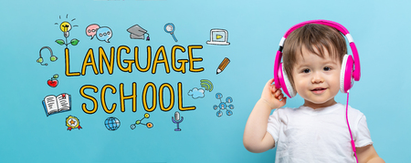 Language school with toddler boy with headphones on a blue background