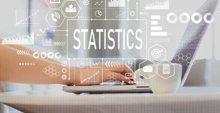 Statistics with woman using a laptop on a coffee table