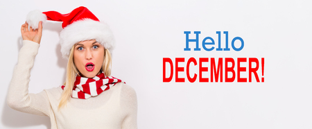 Hello December message with happy young woman with Santa hat