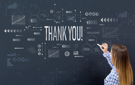 Thank you with young woman writing on a blackboard Stock Photo - 111596745