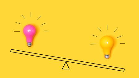 Idea light bulbs on a scale on a yellow background