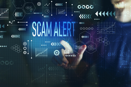 Scam alert with young man on a dark background Stock Photo