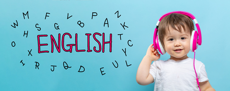 English with alphabets with toddler boy with headphones on a blue background