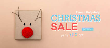 Christmas sale message with a red nose reindeer gift box
