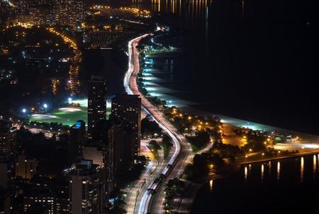 Chicago highway along Lake Michigan aerial view at night
