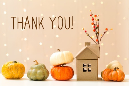 Thank you message with collection of autumn pumpkins with a toy house