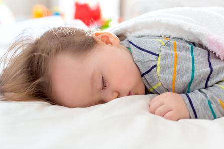 Sleepy little toddler boy taking a nap Stock fotó