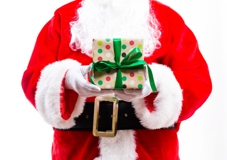 Santa holding a Christmas gift isolated on white background