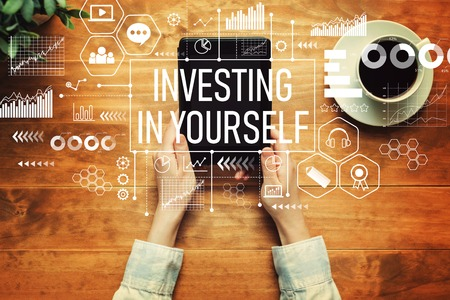 Investing in yourself with a person holding a tablet computer