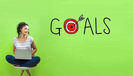 Goals with target with young woman using a laptop computer