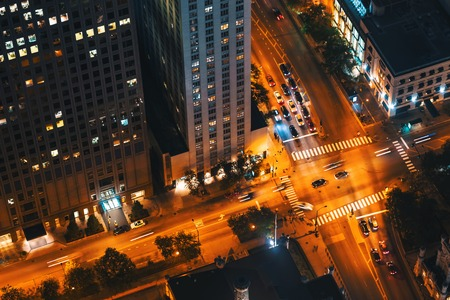Chicago intersection with traffic from high above at night
