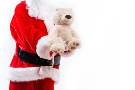 Santa holding a teddy bear isolated on white background 写真素材
