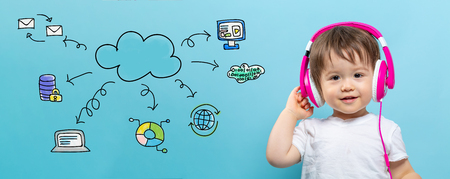 Cloud computing with toddler boy with headphones on a blue background Stock Photo