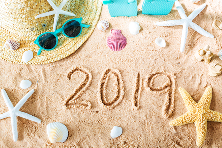 2019 text in the sand with beach accessories Stock fotó