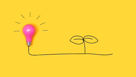 Young plant drawing with a light bulb on a yellow background