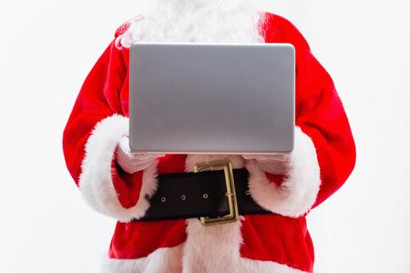 Santa using a laptop isolated on white background