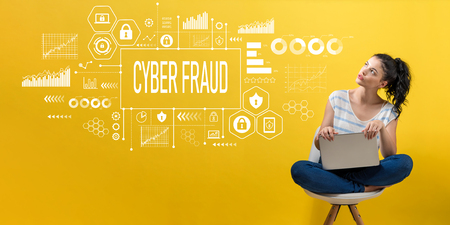Cyber fraud with young woman using a laptop computer Stock Photo