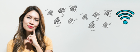 WiFi theme with young woman in a thoughtful fac Stock Photo