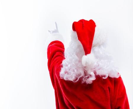 Santa pointing upwards isolated on white background
