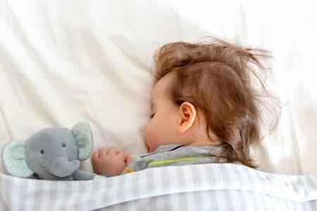 Sleepy little toddler boy taking a nap 写真素材