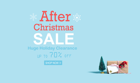 After Christmas sale message with a Christmas gift box and toy tree Stock Photo