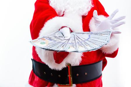 Santa holding US dollar bills isolated on white background