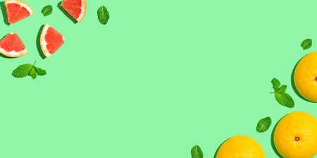 Fresh grapefruits on a bright color background Stock Photo