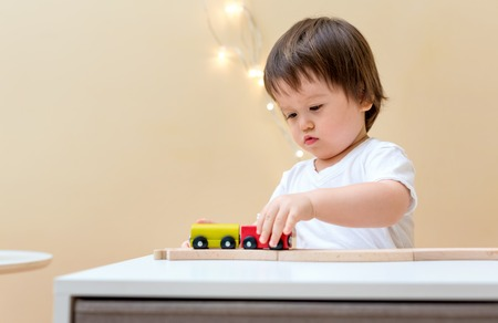 Little toddler boy playing with his toys