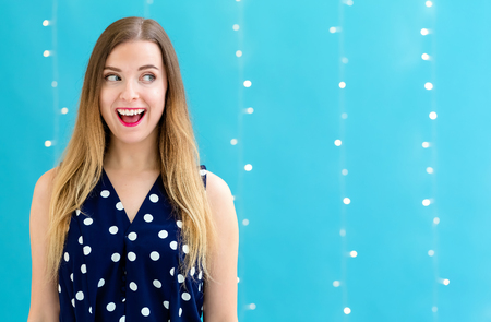 Happy young woman on a shiny light background
