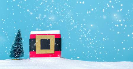 Santa belt gift box in a snow covered landscape
