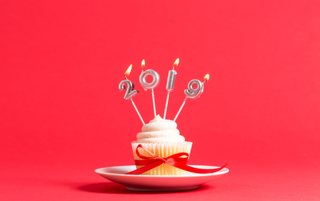 2019 new year celebration theme with cupcake and candles Banco de Imagens