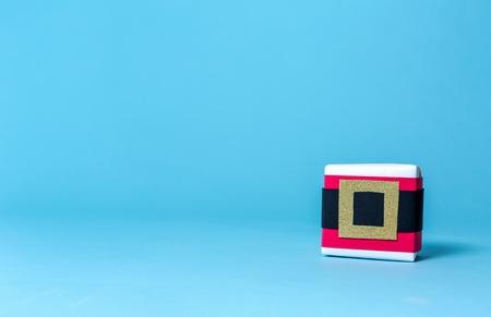 Santa belt gift box on a blue background Stock Photo